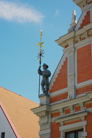 Ancient warrior on the roof of building as an architecture decoration photo