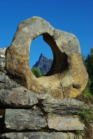 View on the mountain peak thru the stone ring on the old bridge, Hornindal, Norway Stock Photo - 7607536