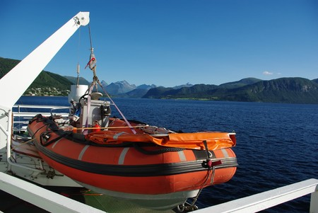 Orange lifeboat aboard the ferry photo