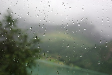 Blur view with raindrops on bus window. photo