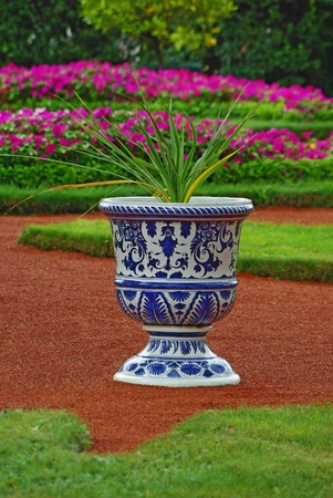 Porcelain vase with the flower as an element of landscape design Stock Photo - 11780693