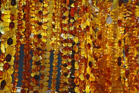 amber coloured: Various amber necklaces are sold in the street market