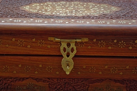 inlay: Engraved wooden chest  with metallic inlay ornament.