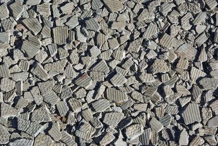 cladding tile: Small pieces of brocken asbestos plate as background  Stock Photo