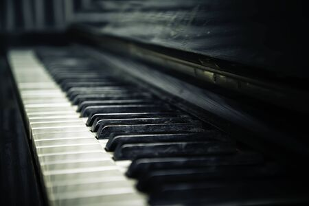 Old, vintage piano. Close-up of piano keys, selective focus. 写真素材