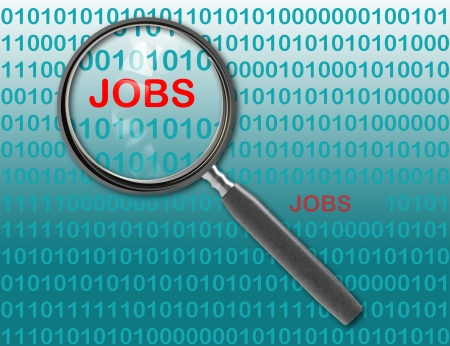 Close up of magnifying glass on jobs Stock Photo