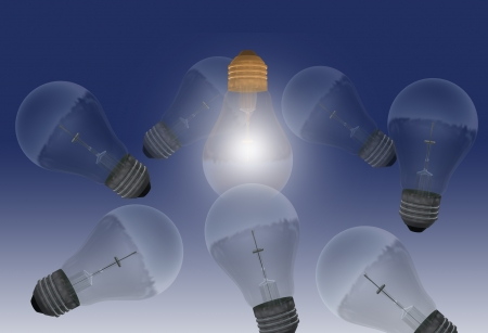One glowing bulb which illustrates  standing out from the others  Stock Photo - 19866357