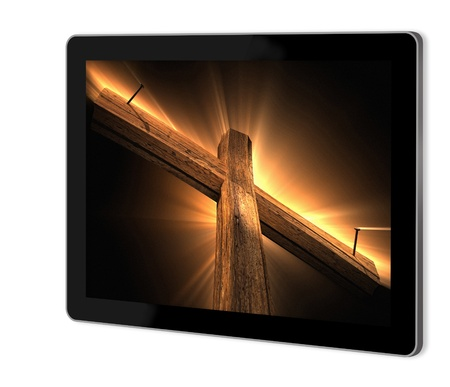 Wooden cross on screen of tablet  made in 3d software Stock Photo - 21173570
