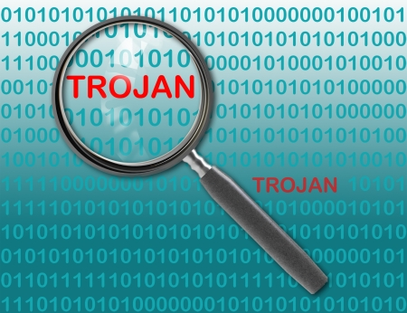 Close up of magnifying glass on trojan photo