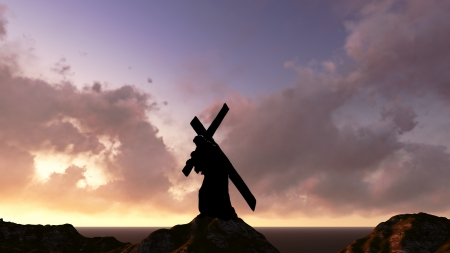 The figure of Christ carrying the cross up Calvary on Good Friday. The sky is dark and stormy. Stock Photo