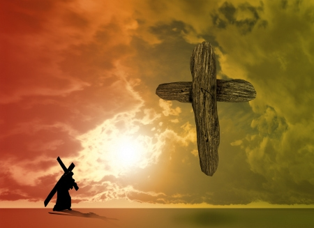 The figure of Christ carrying the cross up Calvary on Good Friday. The sky is dark and stormy. Stockfoto