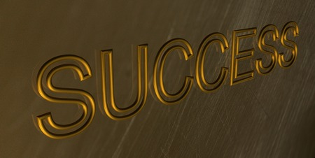 chiseled: The word Success is chiseled by gold letters on a gold wall.