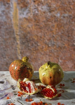 ripe juicy pomegranates with blured background photo