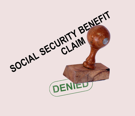 denied: Social Security Claim Denied Stamp Showing Social Unemployment Benefit Refused Stock Photo