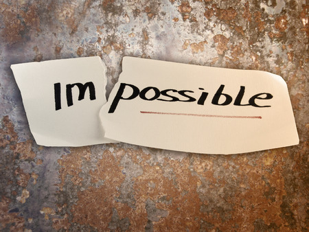 Word impossible transformed into possible. Motivation philosophy concept photo