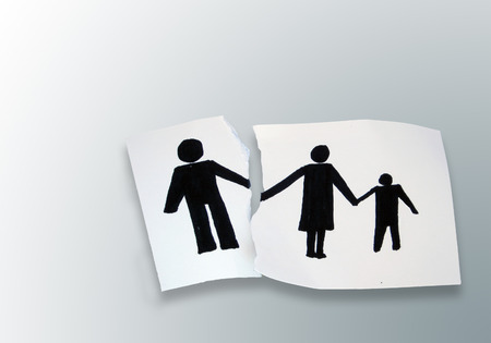 family on a white torn paper  background photo