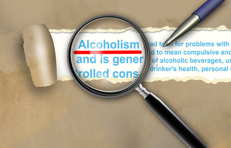 Close-up of alcoholism  with pen on it photo