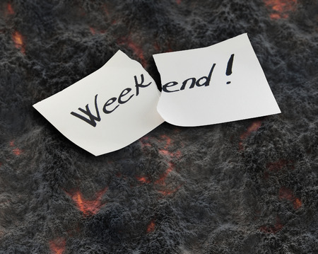 Weekend - Hand writing text on a piece of paper on lawa background photo