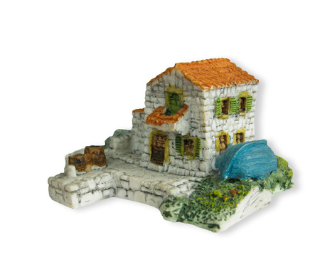 handcrafted souvenir of house  made from stone  made in ceramic photo