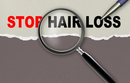hair treatment: word STOP HAIR LOSS  and magnifying glass with pencil made in 2d software Stock Photo