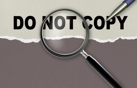 word do not copy and magnifying glass with pencil photo