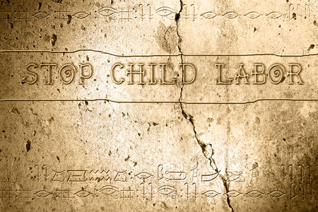 word stop child labor on wall with egyptian alphabet made in 2d software photo