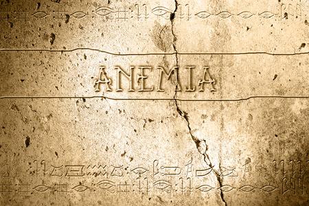anaemia: anemia palabra en la pared con el alfabeto egipcio realizado en software 2d Foto de archivo
