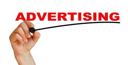 advertise with us: Hand underlining advertising with red marker