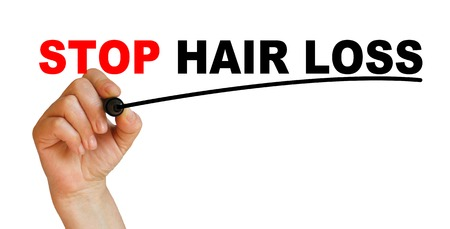 Hand underlining stop hair loss with red marker Stock Photo