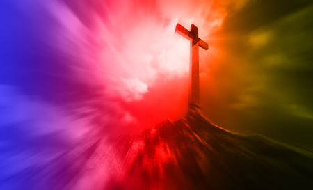 dramatic sky: A wooden cross on a hill at sunset with radial blur Stock Photo