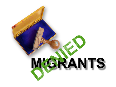 unwanted: Top view of a rubber stamp with a giant word    - denied and word migrants isolated on white Stock Photo