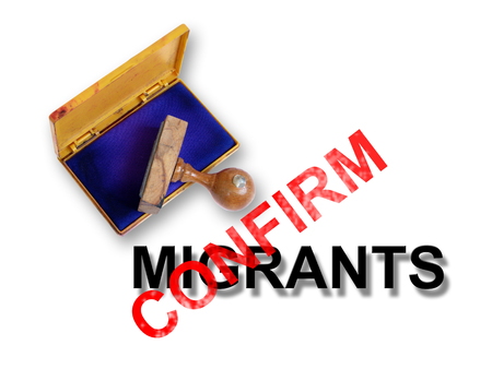 unwanted: Top view of a rubber stamp with a giant word    - confirm and word migrants isolated on white