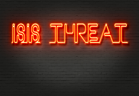 extremist: word isis threat on the wall of bricks     on the wall made in 2d software