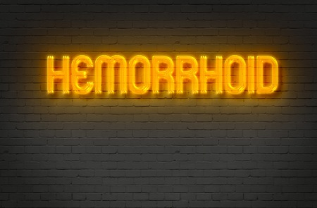 hemorrhoid: writing   words HEMORRHOID   on bricks  background made in 2d software Stock Photo