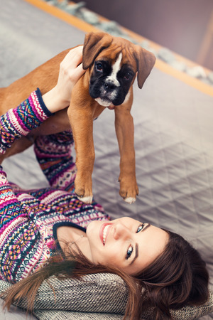german ethnicity: Happy young woman  with a cute german boxer puppy