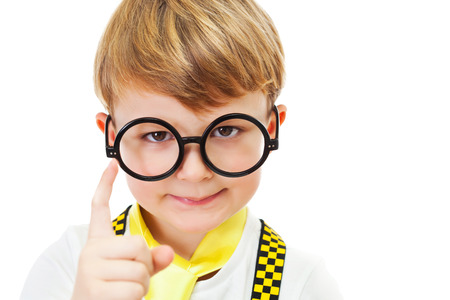proffesional occupation: Portrait of a little boy wearing glasses pointing his little finger at the camera.