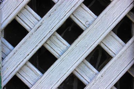 White antique wooden lattice fence close-up, backgrounds and textures Foto de archivo