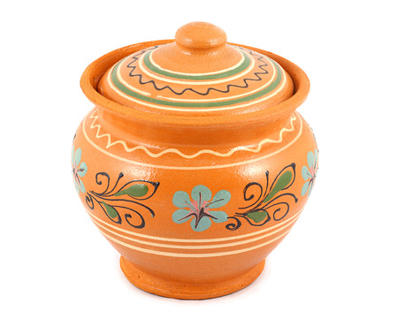 slavic: Antique vintage Slavic earthenware jug, timetable national flowers ornament. White background. Stock Photo