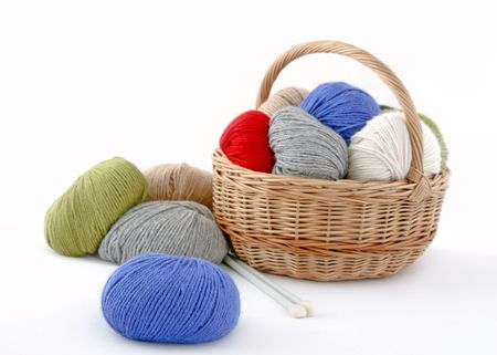 Basket of clews for knitting. (isolated on white)