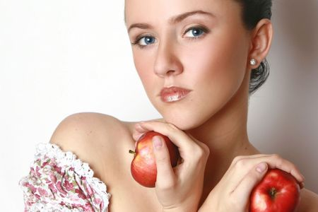 Beautiful young woman with 2 apples. Isolated on white photo