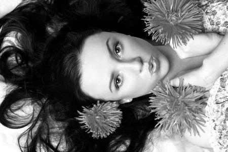 Portrait of a beautiful model in flowers  b&w Stock Photo