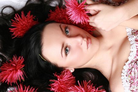 Portrait of a beautiful model in red flowers Stock Photo