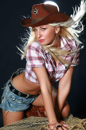 Blonde rodeo girl wearing a cowboy hat. Studio shot Stock Photo