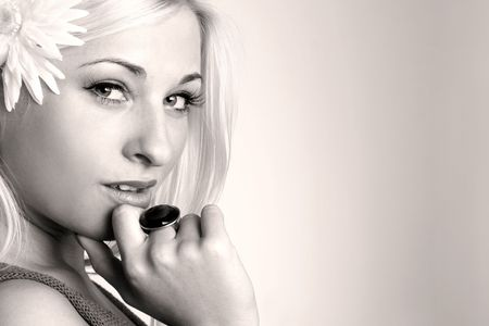 Monochrome close-up portrait of a Beautiful young sexy blonde with flower Stock Photo - 3714204
