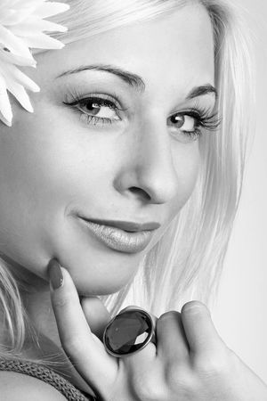 Monochrome portrait of a beautiful sexy blonde with flower Stock Photo - 3714218