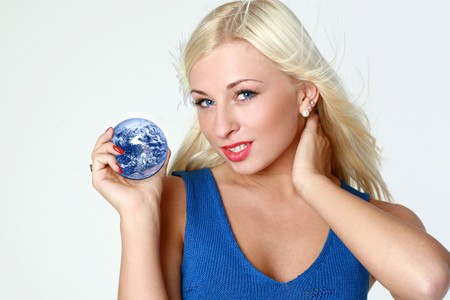 Beautiful sexy blonde with earth in hands on light gray background Stock Photo - 3975927