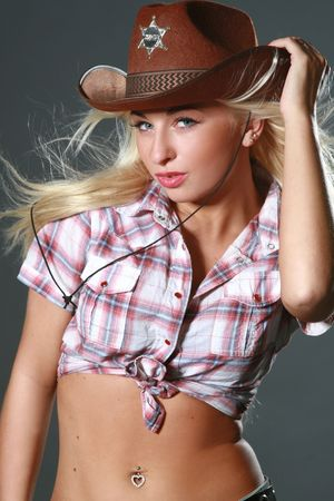 rodeo cowgirl: Beautiful rodeo cowgirl in cowboy hat Stock Photo