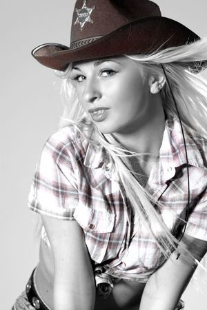 Beautiful rodeo cowgirl in cowboy hat Stock Photo - 5625798