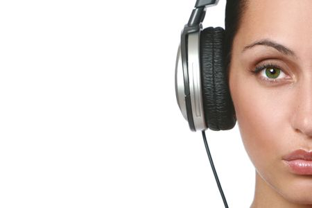 Beautiful women listening music in headphones, isolated on white Stock Photo