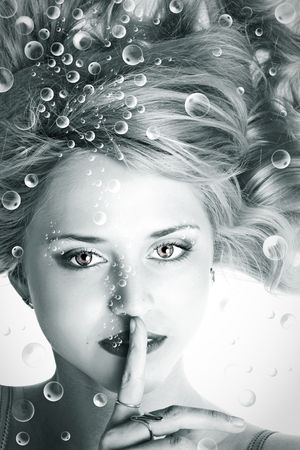 Underwater portrait of beautiful young woman
